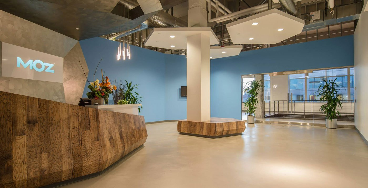 Moz office in Seattle with custom wood furnishings and ceiling elements