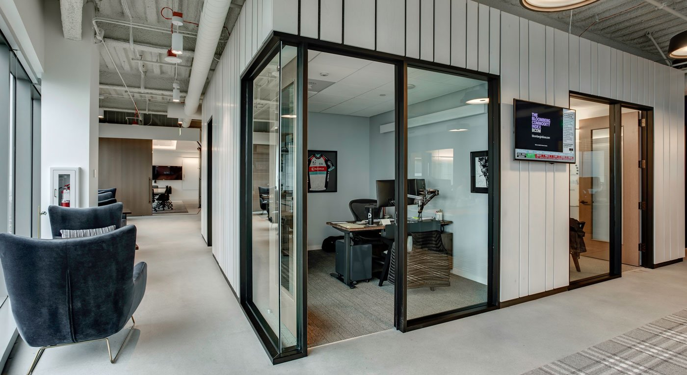 Modern office interior with corner office with big windows